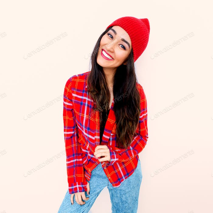 Happy brunette Model Fashion Checkered shirt and beanie cap. Cas