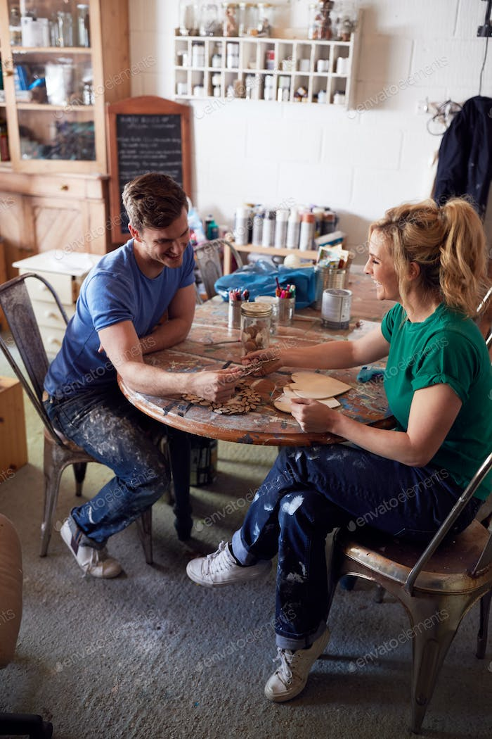 Couple In Workshop Running Business Producing Craft Products