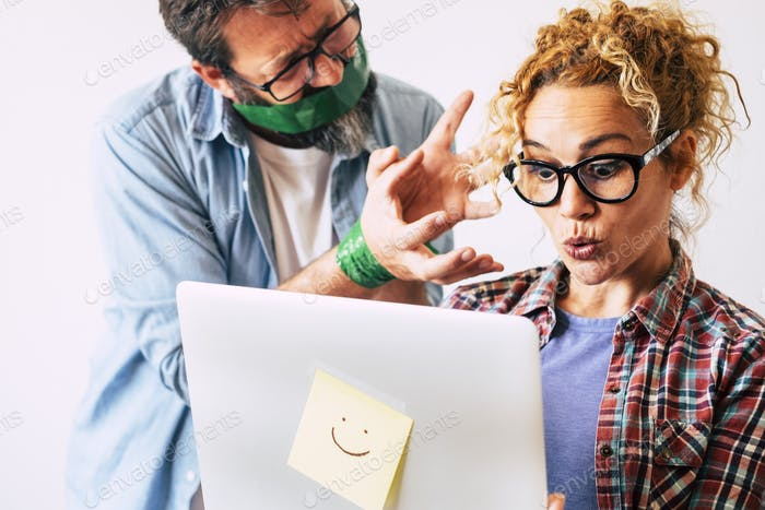 Funny image with wow expression beautiful woman using laptop computer and bound husband man