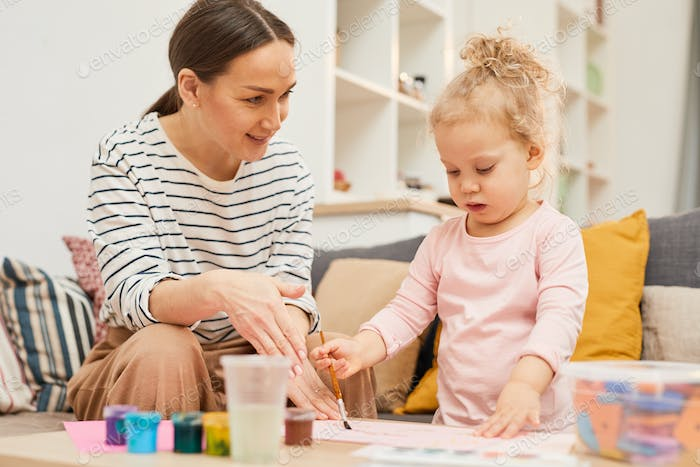 Mother Teaching Girl To Paint