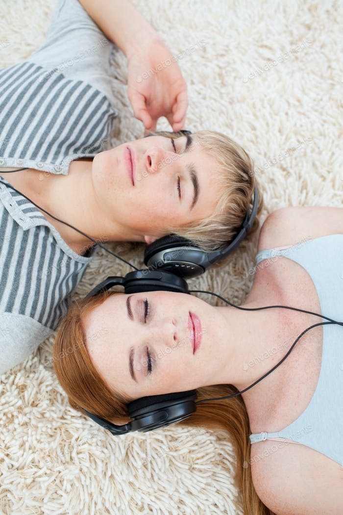 Couple of teenagers listening to music