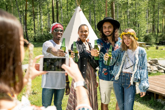 Photographing with beer bottles at countryside festival