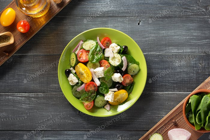 fresh greek salad in plate and ingredients