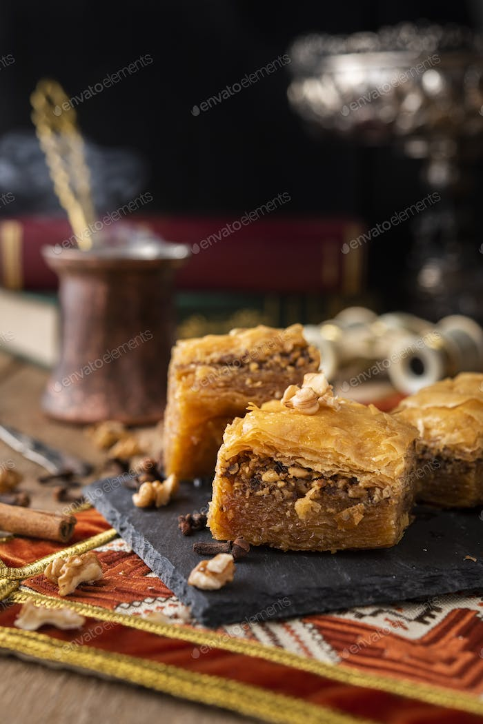 Baklava sweets with nuts on it with coffee and cinnamon