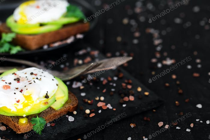 Toasts with avocado and poached eggs background