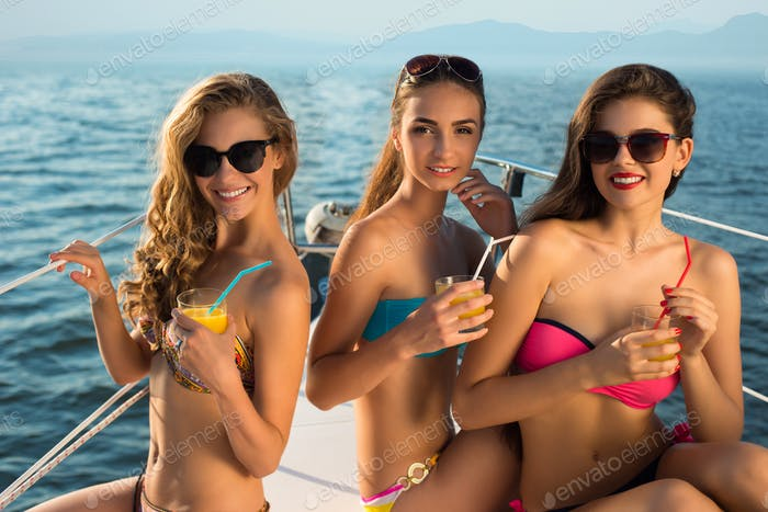 Ladies with drinks on yacht