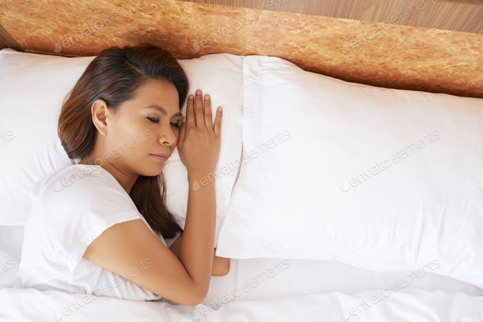 Young Woman Sleeping Alone