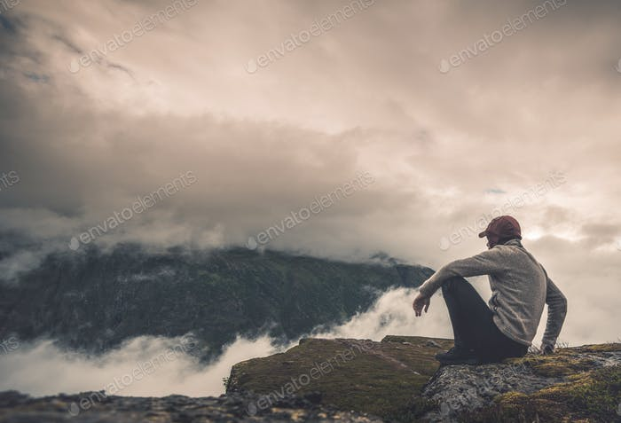 Hiker Resting with Scenic View