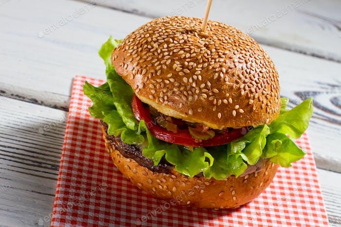 Big burger on napkin.