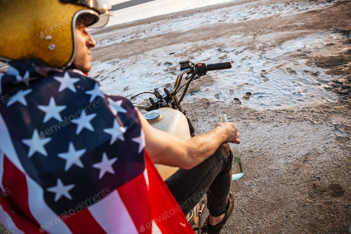 Close up portrait of man wearing helmet and american flag