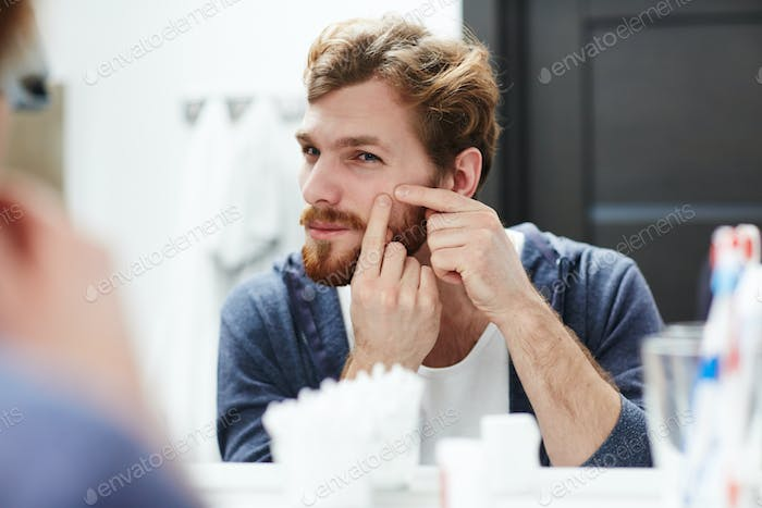 Man with pimple