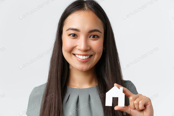 Insurance, loan, real estate and family concept. Close-up of happy smiling pretty asian woman