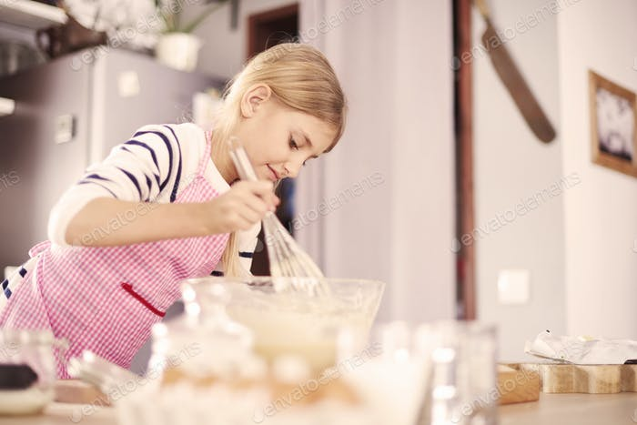 Girl making sweet surprise for family