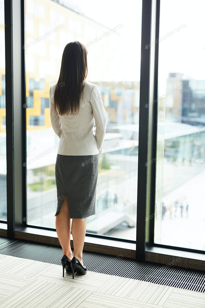 Businesswoman Standing by Window