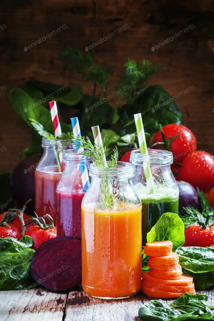 Healthy vegetable smoothie glass bottles with straw