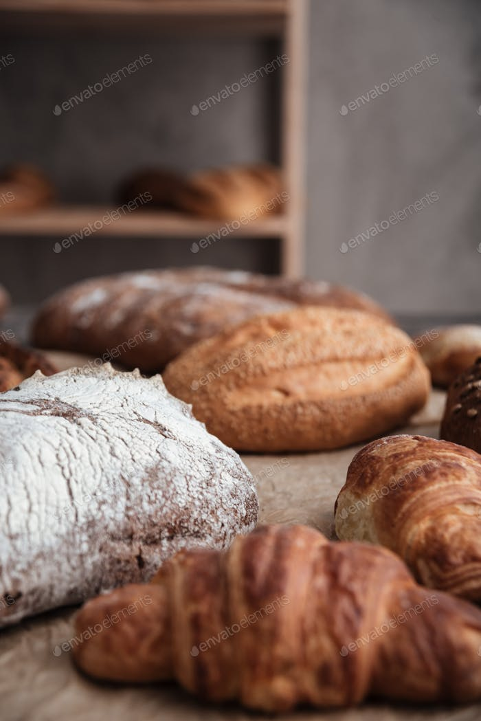 Pastries and bread with flour on table