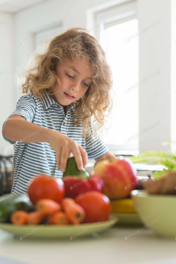Cute boy learning the secrets of healthy nutrition during classes with a dietitian