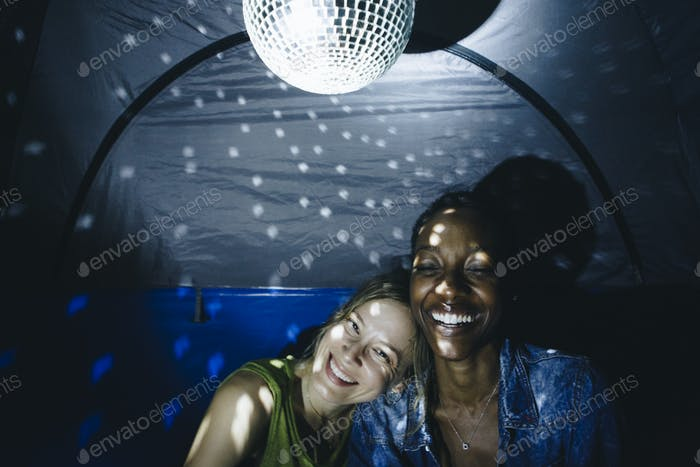 LGBT couple with disco ball