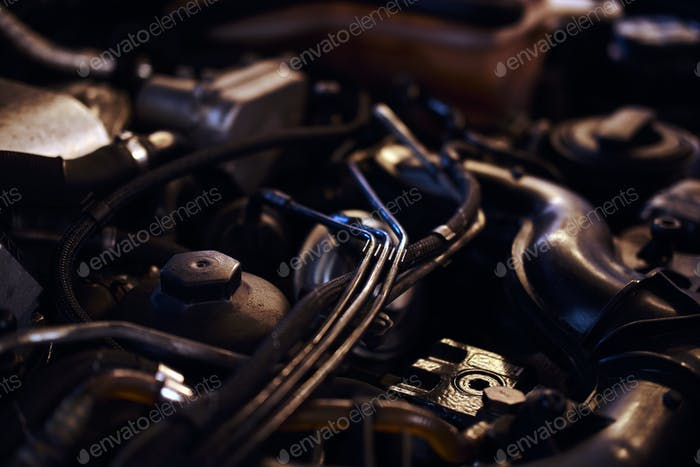 Open car's engine at auto workshop