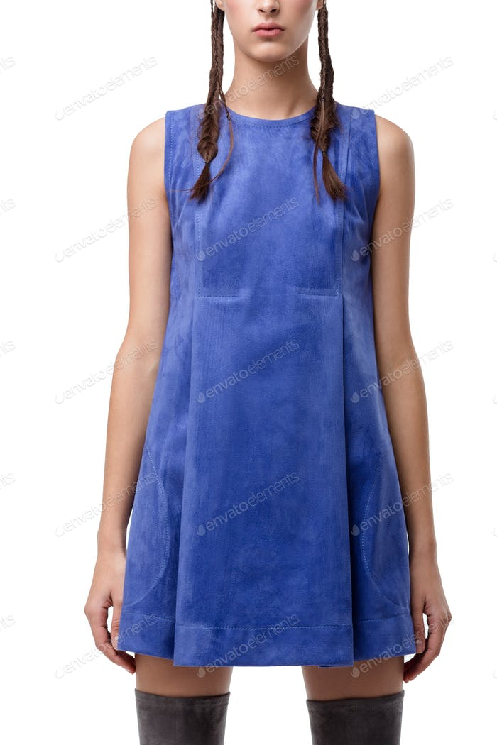 Close up photo of young lady standing in blue suede dress on white background