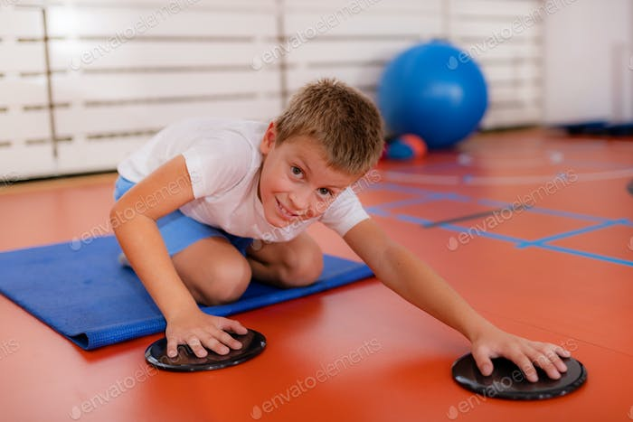 Children training with exercise gliders, improving balance and coordination skills