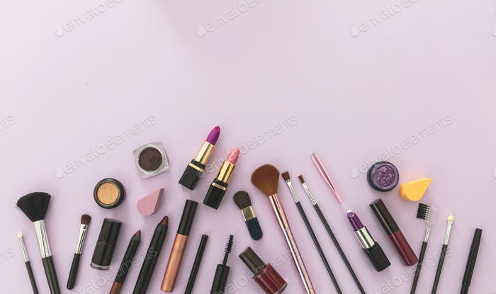 Make up cosmetics products against pastel purple background