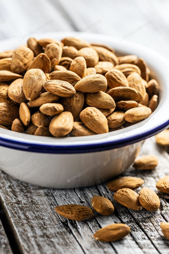 Dried almond nuts in bowl