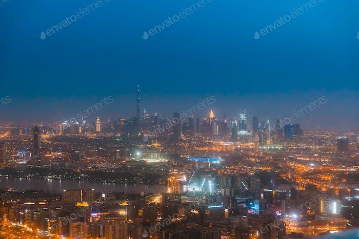 Night Aerial View Of Dubai Cityscape Skyline. Top View Skyline Cityscape City In Night Illuminations