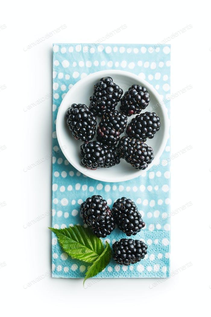 Tasty ripe blackberries in bowl.