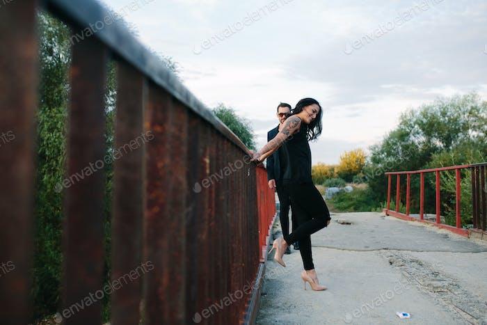 Girl and guy posing outside