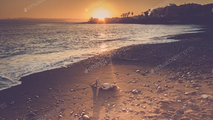 Tourist enjoy the beach at sunset