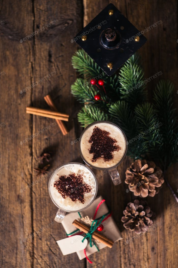 Cocoa on a wooden table with Christmas decorations, branches, sp