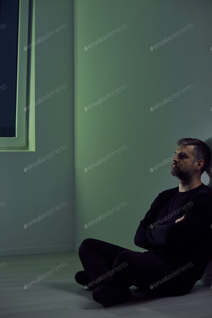 Man sitting in empty room