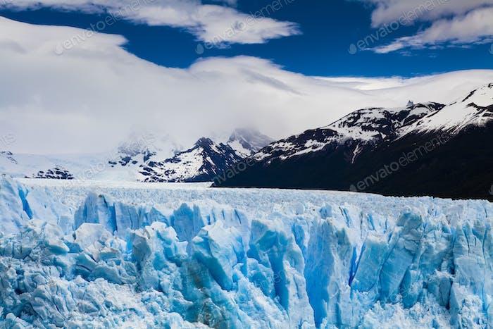 Amazing landscape with blue ice and mountains. Perito Moreno Gla