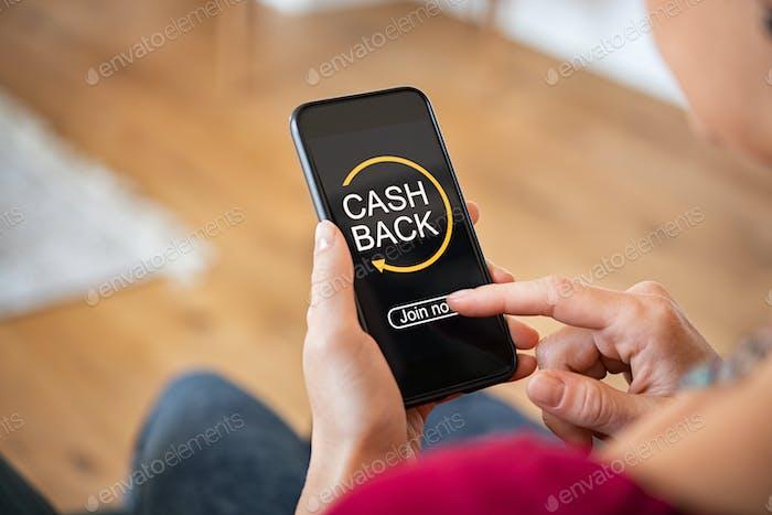 Woman using cashback app on phone
