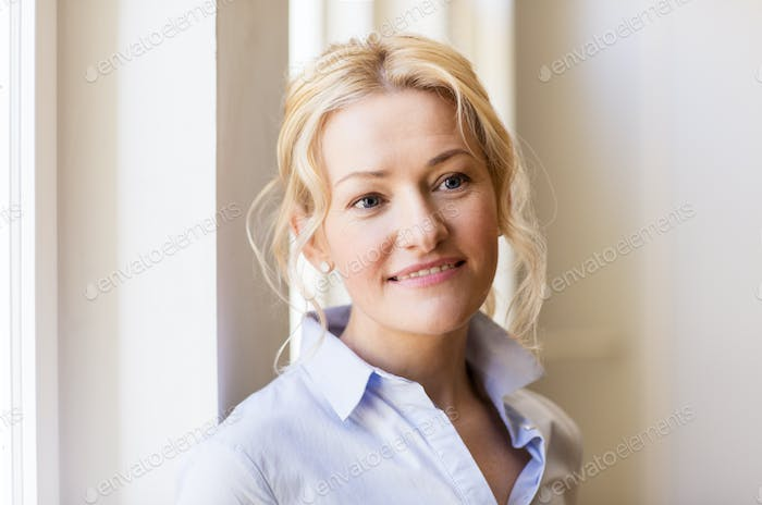portrait of happy smiling beautiful blonde woman