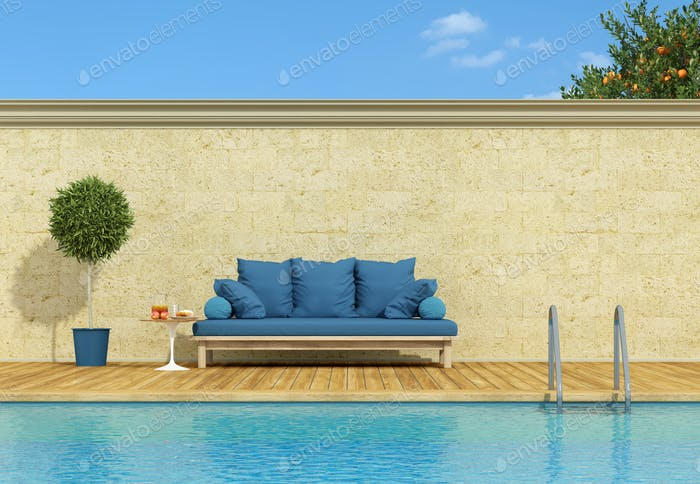 Blue sofa poolside