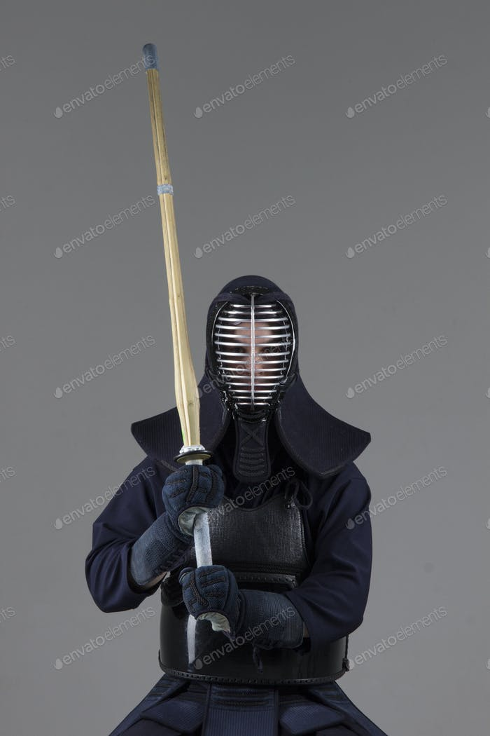 male in tradition kendo armor with bamboo sword