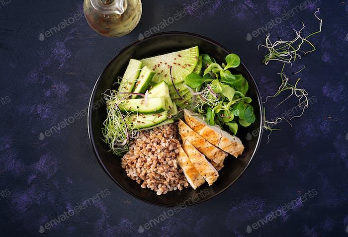 Buddha bowl with buckwheat porridge, grilled chicken fillet, corn salad,