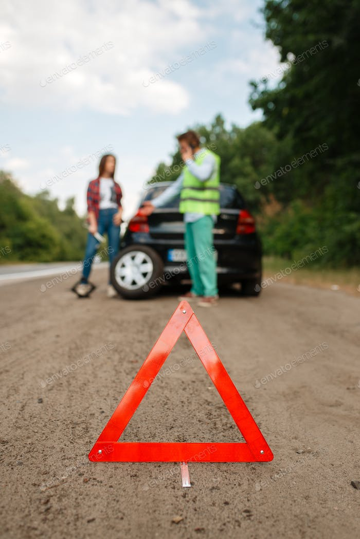 Emergency stop sign, flat tyre, punctured tire