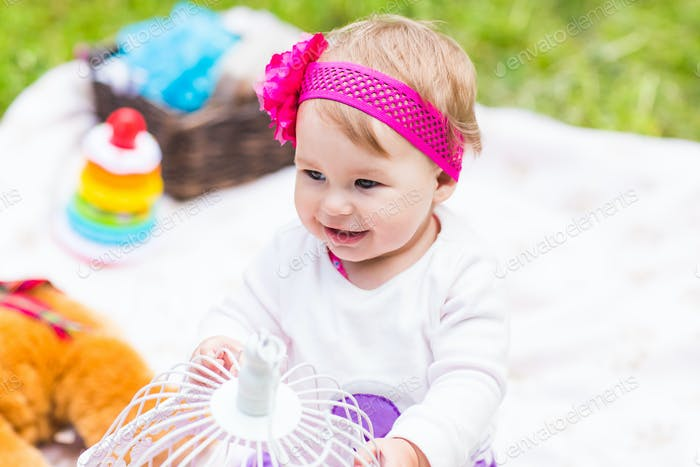Adorable baby girl smile picnic playful weekend nature