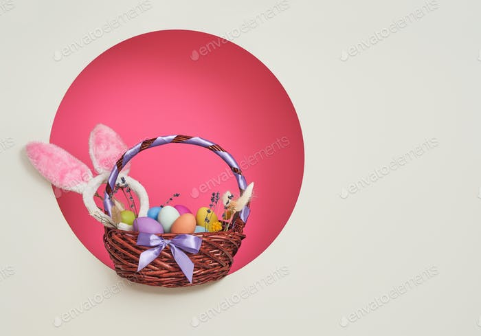 Background with colorful eggs in basket.