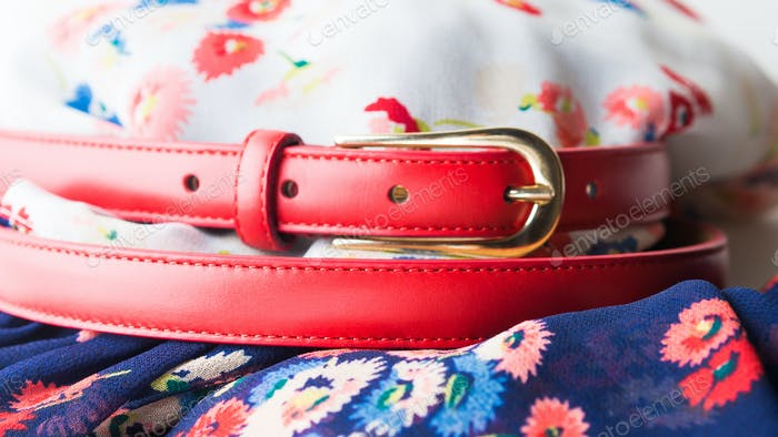 Floral pattern dress with red belt