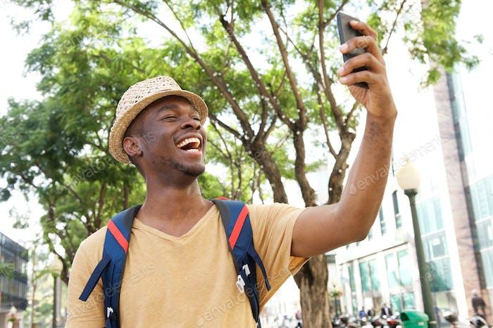 happy african american tourist taking selfie photos
