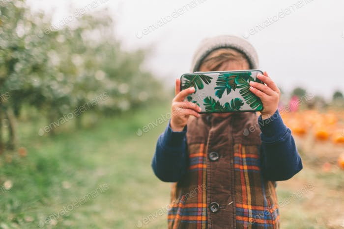 Little Boy Taking a Photo