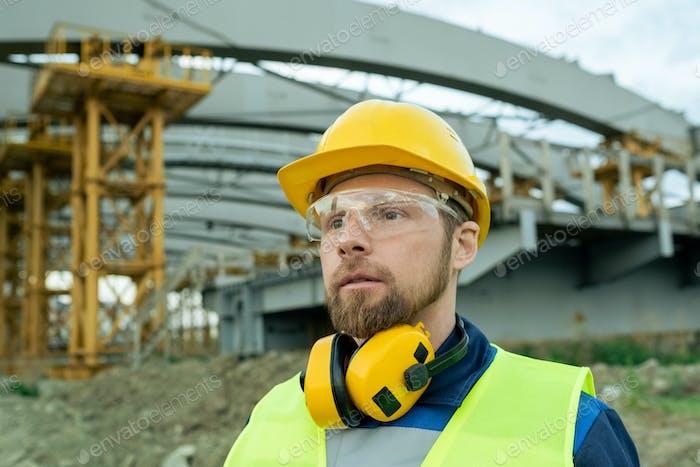 Builder in work helmet outdoors