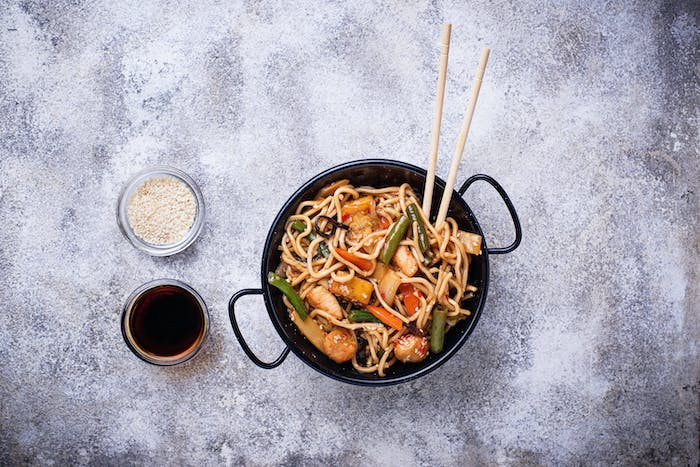Stir fry noodles with chicken, tofu and vegetable.