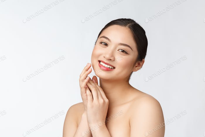Beautiful asian woman makeup of cosmetic, girl hand touch cheek and smile, face of beauty perfect