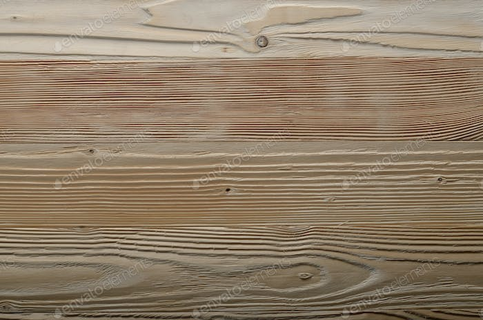 Weathered pine wood planks background with grained surface. Plac
