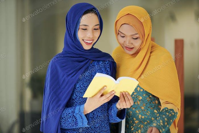 Muslim women reading holy book